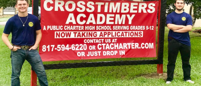 Crosstimbers Academy Students Standby an Advertisement for CTA